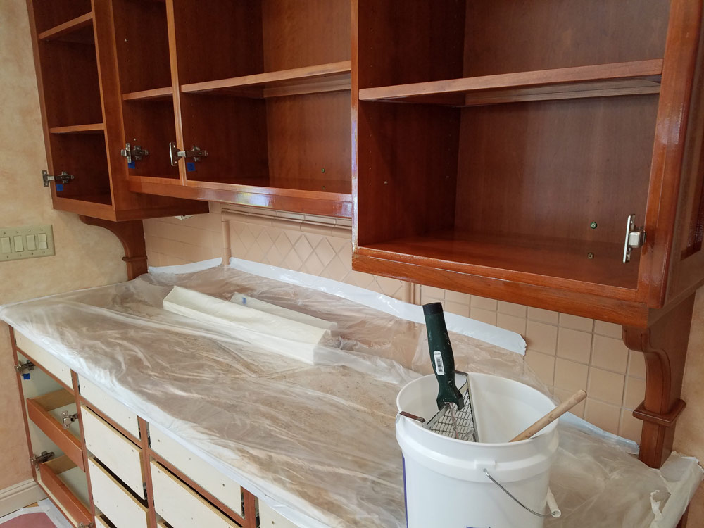 At our shop we stripped sanded and refinished the cabinet fronts and drawers. We removed the cabinet hardware before working on the cabinet fronts and ... & Kitchen Cabinet Refinishing Project with a Red Cherry Mahogany ...